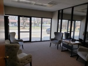 First Responders entryway with four grey, wingback chairs
