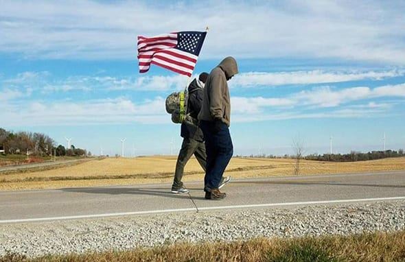 Men Walking with US Flag